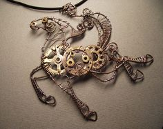 Wire wrapped steam punk horse pendant.