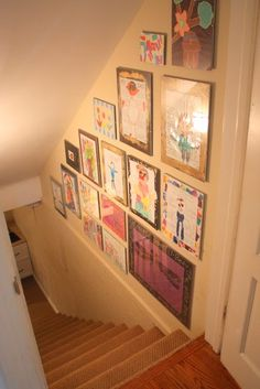 Our basement stairs is like this. I have one glass clip frame there but this would be interesting to do. STARTED: May 2012.
