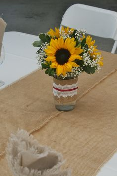 Sunflowers in a mason jars with baby's breath, burlap and lace. Made at your…