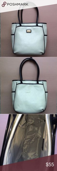 """Beijo White Purse w/Black Piping Black and white are always in STYLE. The Mia gorgeous Beijo bag is perfect for most outfits.  The front and back have a large pocket that snaps shut. Inside -  there are two pockets in the front and one zippered pocket in the back.  The top of the bag has a zipper so your valuables are kept safe.  Measurements:  Height - 10""""/Length - 9.5""""/Width - 7.5""""/Drop - 9.5"""" Beijo Bags"""