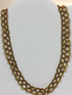 Gold netted necklace by Maxine.