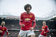 Marouane Fellaini celebrates scoring in this brilliant photograph taken by Sportsmail snap...