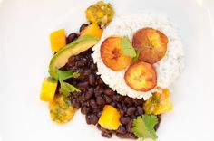 Coconut rice with black beans, plantains and mango salsa... yummmm.