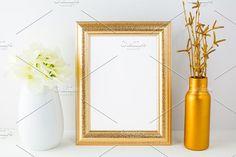 Gold frame mockup with golden vase by TSTStockMockupPhotos on @creativemarket