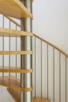 Brushed stainless steel centre column for this spiral stair