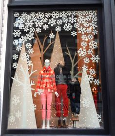 these paper snowflakes and trees in this JCrew store window. Love these paper snowflakes and trees in this JCrew store window.Love these paper snowflakes and trees in this JCrew store window. Winter Window Display, Christmas Window Display Retail, Christmas Windows, Christmas Store Displays, Store Front Windows, Retail Windows, Vitrine Design, Store Window Displays, Display Windows