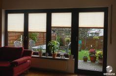 Faltrollo Plissees von sensuna® an Fenstern und Terrassentür