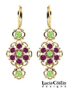 Lucia Costin Lever Back Dangle Flower Earrings Made of 14K Yellow and Pink Gold over .925 Sterling Silver Crafted with Light Green, Violet Swarovski Crystals, Dots and Twisted Lines Lucia Costin. $68.00. Unique and feminine, perfect to wear for special occasions and evenings. Romantic floral design. Produced delicately by hand, made in USA. Flower earrings by Lucia Costin. Beautifully designed with peridot and purple Swarovski crystals