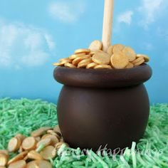 """""""To make my Pot of Gold Caramel Apple, I added a modeling chocolate rim to a chocolate dipped caramel apple then cut out small circles from some white modeling chocolate using a small round fondant cutter. To add shimmer, I dusted the circles with gold luster dust, and set them in my pot."""""""