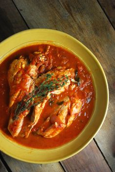 Chesapeake Bay Rockfish Stew, prepared with a zesty tomato stock flavored with fresh herbs.