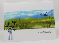 one layer card with a band of a gorgeous created scene...like the effect of stamping a simple silhoute over the edge of the scene...