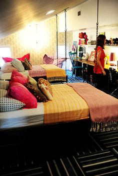 Hanging beds and a looong desk. This is a great idea for the kids in middle school!
