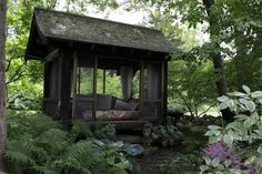 An Asian-style sleeping pavilion, tucked into the shade garden, is stocked with cozy pillows.