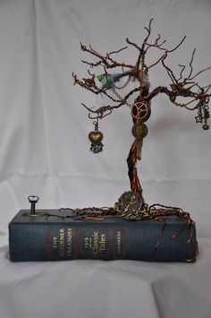 Copper wire memory  tree with steam punk and vintage watch parts mounted on vintage book.. $75.00, via Etsy.