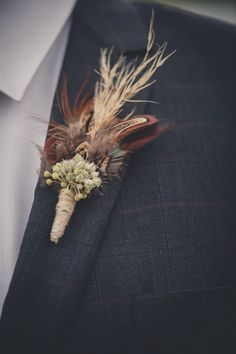 Feathered Boutonniere. Perfect for a rustic, fall wedding.