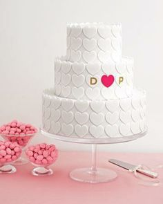 adorable heart cake with initials highlighted.  3 tiered cake.