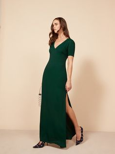 If you're into looking good with literally zero effort, this dress may be right for you. This is a full length dress with a high side slit, slightly puffed shoulders, and a v neckline.