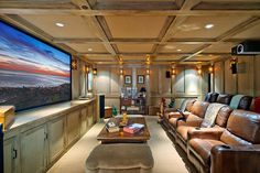 Traditional Home Theater with Crown molding, Box ceiling, Durasupreme cabinets - craftsman style panel, Built-in bookshelf