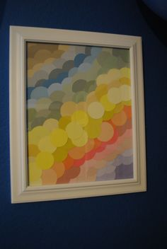 Circle punch and a whole bunch of paint chips = a really cool piece of DIY artwork