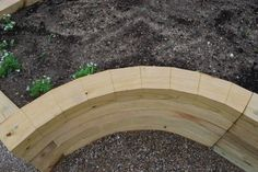 DIY:  How to Create a Curved Raised Garden Bed - the cut in the wood is called a kerf. The saw removes small parallel slices of wood from the board. After soaking the boards overnight, the wood is bent into place. Via DeborahSilver.com