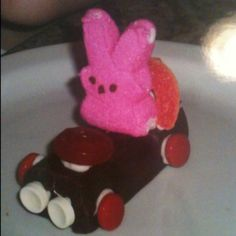 Bunny Racers: Little Debbie Swiss Cake Roll. Use canned frosting to attach 4 Spree wheels, 2 Smartie headlights, 1 Gummy Life Saver steering wheel, 1gummy peach ring and 1 Peep bunny driver.
