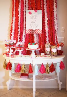 Red, hot pink, aqua and gold Dessert Table by Petite Party Studio