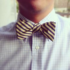 Wear a bowtie or no tie! These stripe go well with Tattersall check, also like small dotted tie with plaid shirt. Often ties bowties look best with suspenders or a vest for a dressy casual event like Kiki's wedding.