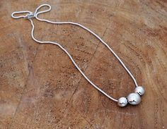 Three Pebble necklace. Handmade Sterling Silver Sphere jewelry, Spherical jewelry, Geometric jewelry, Tactile jewelry, Pebbles, Silver ball ............................................................................................................................  Welcome to Park Road Jewellery. Jewellery handmade to the highest standard using quality tools and materials, in a simple yet refined style. Each piece is lovingly handcrafted and finished to exacting standards to ensure you own a…