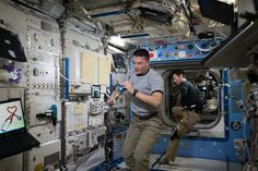 https://flic.kr/p/ynD2zo | iss044e080061 | ISS044E080061 (09/01/2015) --- NASA astronaut Kjell Lindgren and JAXA astronaut Kimiya Yui are seen working inside the U.S. Destiny Laboratory. Lindgren is using one of the space station's space-to-ground communicators to talk with support staff on Earth.
