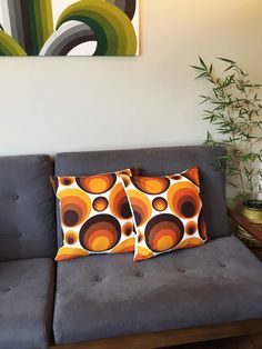 Bold retro/mid century cushions made by me, with Evelyn Redgrave's Cascade fabric for Heals on the wall above. https://www.etsy.com/uk/listing/528112500/cushion-cover-in-vintage-retro