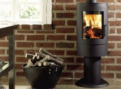 The Westfire Uniq 21 Pedestal Leg Wood Burning Stove is compact in size and its low output makes it ideal for smaller rooms. Primary air, secondary air and tertiary air supplies give the Westfire Uniq 21 woodburner an efficiency of over The rounde Snug Room, Cosy Room, Modern Wood Burning Stoves, Wood Stoves, Insert Stove, Solid Fuel Stove, Cast Iron Fireplace, Into The Woods