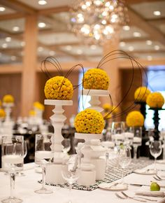Yellow, Black and White Centerpieces – shared on The Knot