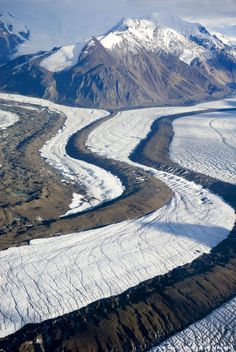 Aerial view of Mt. Blackburn and Kennicott Glacier, Saint Elias Range, Wrangell-St Elias National Park and Preserve, Alaska - The mountain ranges of Wrangell-St. Elias account for 60 percent of glacial ice in Alaska, covering more than 1,700 square miles. The glaciers have advanced and retreated repeatedly, reaching the sea and filling the valley of the Copper River.