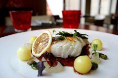 Cod fish with potatoes, capers and lemon emulsion