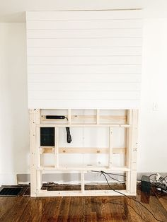 Step by step tutorial on how to build an inexpensive shiplap fireplace using an electric insert. Transform your boring TV wall into a statement piece. Fireplace Feature Wall, Diy Fireplace Mantel, Fireplace Tv Wall, Build A Fireplace, Fireplace Built Ins, Shiplap Fireplace, Rustic Fireplaces, Fireplace Design, Magnolia Home Decor