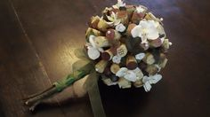 corks in a bouquet?? great idea for a wine themed wedding like mine!