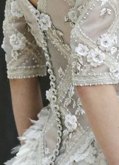 Chanel Haute Couture, Spring/Summer 2013.  Love the buttons!