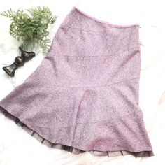 Lovely lilac fit and flare anthropologie skirt This is the perfect wool cute anthro skirt. Fully lined. The color on this skirt is perfect. It's a lilac speckled blend. Also the love detailing on the hem is a great touch. Length is 25 where the lace like material ends. Waist 14 (side zipper) hips 18 Anthropologie Skirts Midi