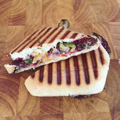 Goetta + Brussels sprouts + raspberry jam + cheddar + Monterrey jack Panini / fire and knives