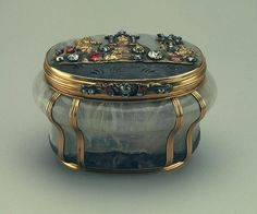 Carl Fabergé (1846 – 1920); gorgeous carved hard-stone box with gold fittings encrusted with rubies and diamonds.