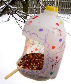 "plastic jug bird feeder; found at Lucky Me! Who needs money for a bird feeder??? how cute and fun for the kids to watch the birds eat at the ""kitchens"" they made!"