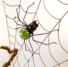 http://www.etsy.com/listing/40433529/spider-web-driftwood-and-copper-wire?ref=tre-2722906850-10