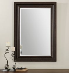 """Uttermost Adalwin Mirror. Features a solid wood frame finished in lightly distressed, dark bronze. Mirror has a generous 1 1/4"""" bevel. May be hung horizontal or vertical."""