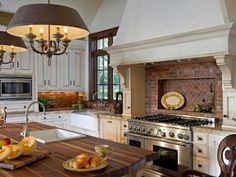 Photo of White Moroccan Kitchen project in Winter Park, FL by Phil Kean Designs