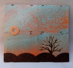 "www.greenlifegallery.com  ""Autumn Dusk""  This piece was made using discarded CDs & DVDs and their plastic ""jewel"" cases serve as the canvas.    The intent is to create original works of art while diverting non-recyclables from our landfills.  #CD #DVD #cases #plastic #art #eco-art #green #upcycled #recycled #media #disc #painting #autumn #dusk #tree #sunset #reuse #creative #décor"