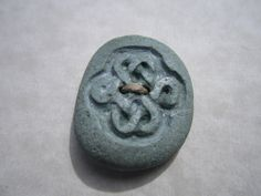 Carved Beach Stone Button- Carved Love Knot Button- Celtic Knot Button. $38.00, via Etsy.