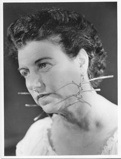 Peggy wearing the earrings created for her by Alexander Calder