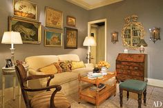 Eighteenth-century needleworks decorate a wall in the sitting area of the master bedroom in a New York apartment designed by Joanne DePalma.