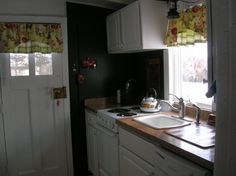 Converted caboose kitchen.  From Hooked on Houses.  This woman lives somewhere in Northeast PA in this renovated caboose.