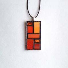 "Gorgeous color block style orange stained glass mosaic pendant. Silver-plated base with 18"" waxed cotton cord. Hand created by NiagaraGlassMosaics on Etsy"